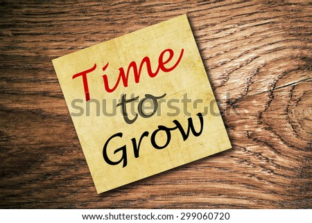Time to Grow Note Paper on wood table. Top view - stock photo