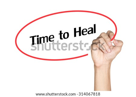 Time to Heal Men arm writing text with highlighter pen on white background - stock photo