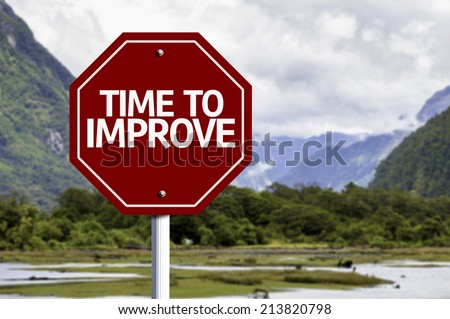 Time to Improve red sign with a landscape background  - stock photo