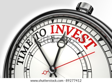 time to invest concept clock closeup on white background with red and black words
