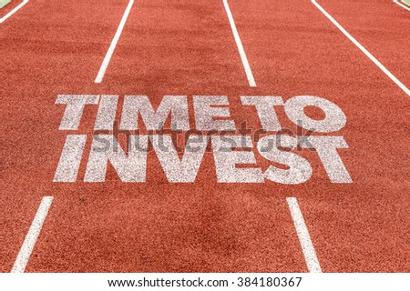 Time To Invest written on running track