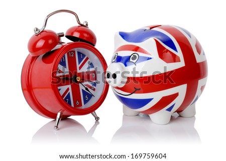 Time to make money in Britain piggy bank and alarm clock isolated on a white background - stock photo