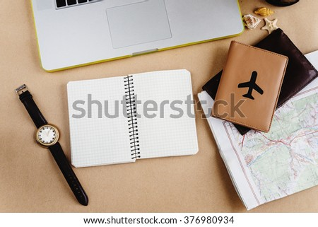 time to plan travel concept, stylish notebook map watch and passport on craft background - stock photo