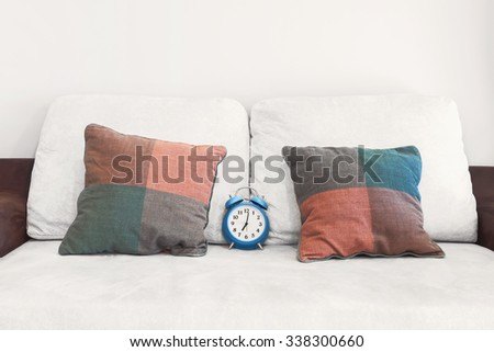 time to relax on sofa - stock photo
