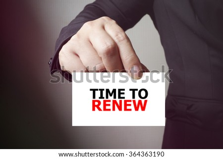 TIME TO RENEW paper on the card , business concept , business idea - stock photo