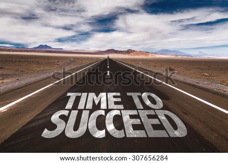 Time to Succeed written on desert road - stock photo