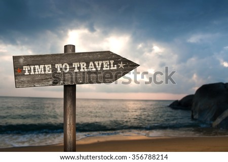 Time to Travel wooden sign with holiday background