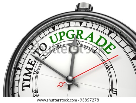 time to upgrade concept clock closeup isolated on white background with red and black words