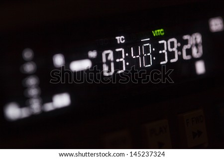 Timecode running on the professional video recorder. Macro shot with perspective. - stock photo
