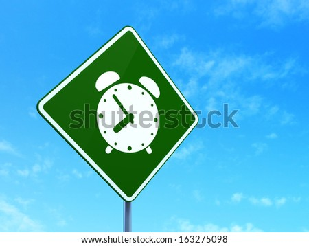 Timeline concept: Alarm Clock on green road (highway) sign, clear blue sky background, 3d render - stock photo