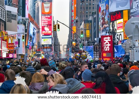 TIMES SQUARE - DECEMBER 31:  Huge crowds form in Times Square In Manhattan for New Years Eve on December 31, 2010 in Times Square, New York City.