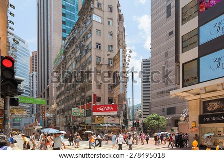 TIMES SQUARE, HONG KONG - MAY 30, 2014: Busy intersection scene of Hong Kong Times Square. Hong Kong Times Square is a major tourist attraction with many shops and restaurants.