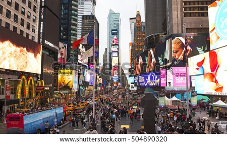 TIMES SQUARE IN NEW YORK CITY - JUNE 4, 2015: Famous tourist attraction featured with hundreds lights, Broadway Theaters, restaurant and stores is nestled in the centre of Manhattan in New York City.