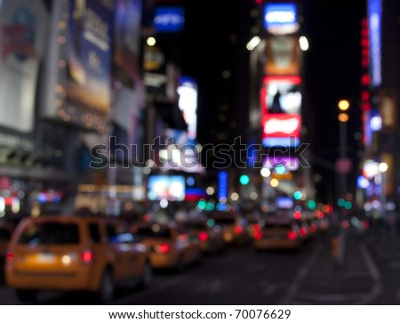 Times Square lights at night/Times Square at Night/Blurred picture of Times Square lights and traffic at night