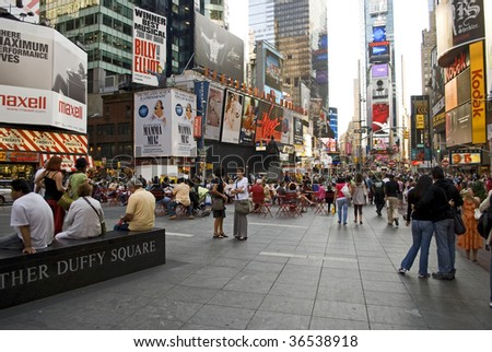 TIMES SQUARE, NYC - SEPTEMBER 2: Tourists and pedestrians enjoy the open space, tables and chairs due to the closing of Broadway to traffic between 42nd and 47th St September 2, 2009 in Times Square. - stock photo