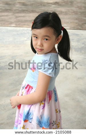 Timid girl with shy face expression standing alone