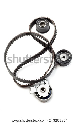 Timing belt, two rollers and the tension mechanism. Isolate on white. - stock photo