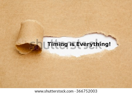 Timing is Everything, appearing behind torn brown paper.