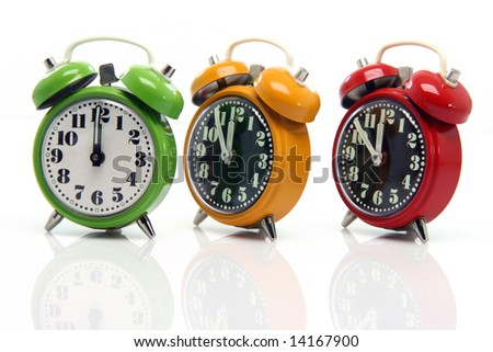 timing red yellow and green alarm clock untill twelve oclock closeup with nice reflection - stock photo
