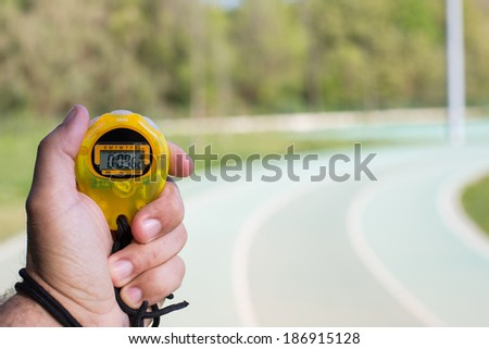 Timing times on a track a girl athlete - stock photo