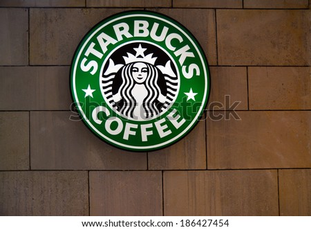 TIMISOARA, ROMANIA - APRIL 6, 2014: The Starbucks Coffee sign in Iulius Mall, Timisoara - stock photo