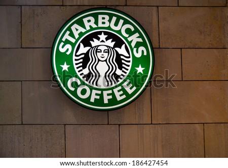TIMISOARA, ROMANIA - APRIL 6, 2014: The Starbucks Coffee sign in Iulius Mall, Timisoara - stock photo