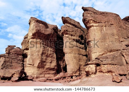 TIMNA, ISR - OCT 15:Visitor at Solomon's pillars on October 15 2008.The red Sandstone cliffs in Timna Valley called after King Solomon's Pillars at the first Jewish Temple in Jerusalem,Israel.