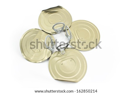 Tin can lids with opener in form of clover  isolated on white  - stock photo