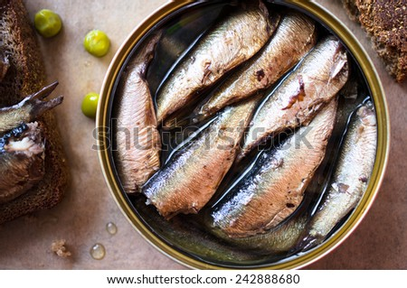 Tin can of sprats, sardines. Top view - stock photo