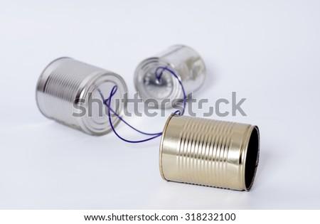 Tin can phone.Telecommunication concept - stock photo