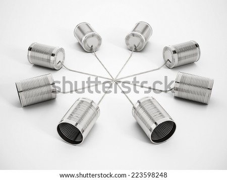 Tin can phones connected to each other. - stock photo