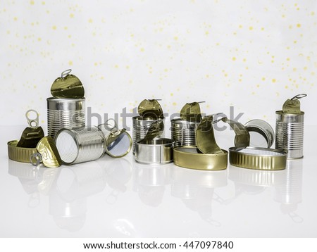tin cans of conserved food ready to recycle on  white background - stock photo