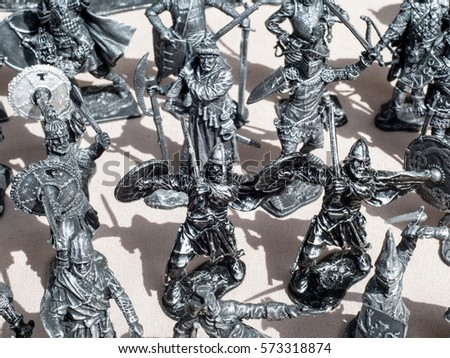 tin soldiers. a toy soldier made of metal.