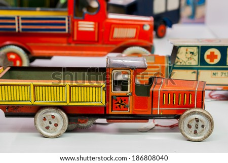 tin toy cars made by hand dating back to the early nineteen hundred - stock photo