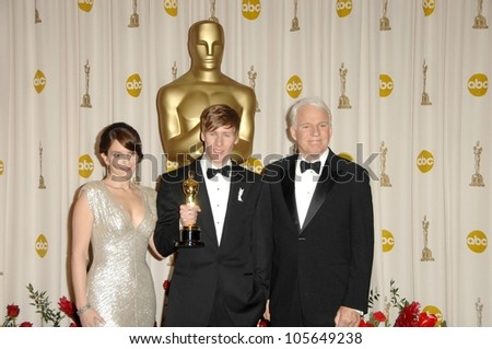 Tina Fey with Dustin Lance Black and Steve Martin  in the Press Room at the 81st Annual Academy Awards. Kodak Theatre, Hollywood, CA. 02-22-09
