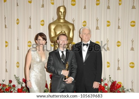Tina Fey with Simon Beaufoy and Steve Martin in the Press Room at the 81st Annual Academy Awards. Kodak Theatre, Hollywood, CA. 02-22-09