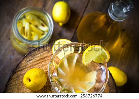 Tincture of quince and fruit on a wooden table - stock photo