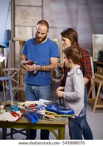 Tinkering family in workshop.