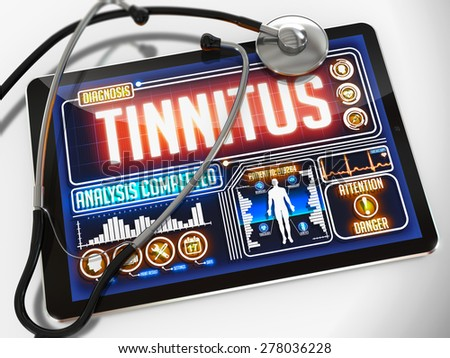 Tinnitus - Diagnosis on the Display of Medical Tablet and a Black Stethoscope on White Background.