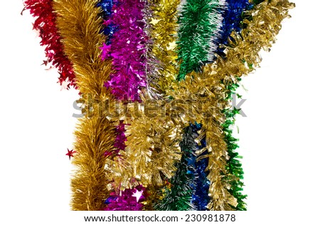 Tinsels of different colours. Located on a whole background. - stock photo