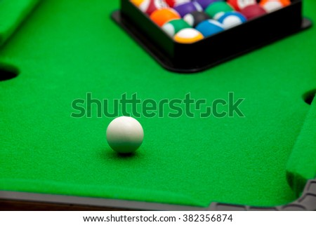 Tiny billiards game toy  - stock photo