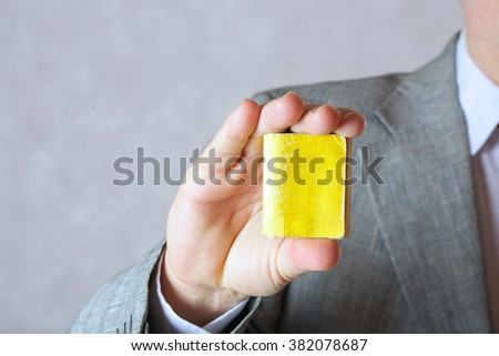 Tiny book in the hand of a business man. Closeup.Free space for a text