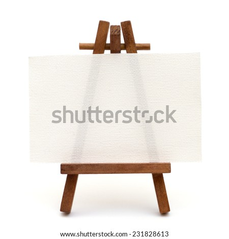 Tiny canvas on easel isolated on white background