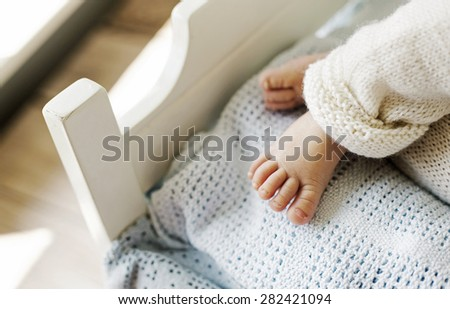 Tiny feet of a newborn child - stock photo