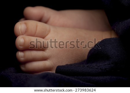 Tiny foot of newborn.