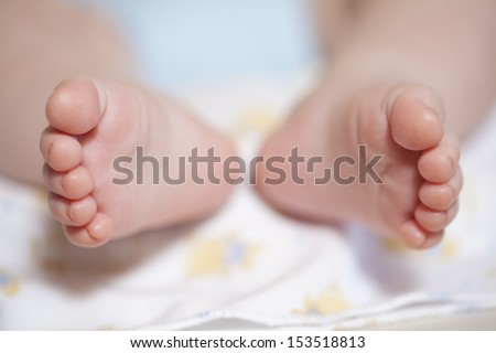 Tiny foot of newborn baby