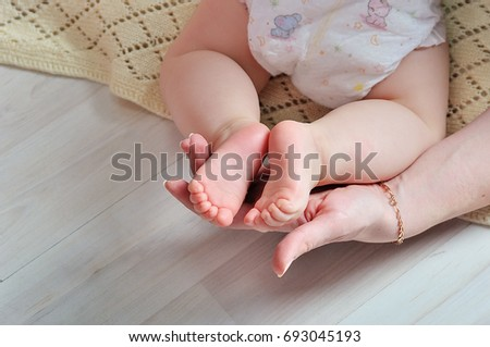 tiny foot of newborn baby in soft selective focus