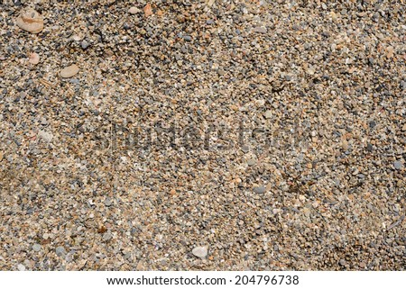 Tiny grains of sand macro close up texture. - stock photo