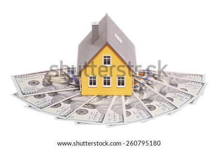 Tiny house and money isolated. Mortgage Concept - stock photo
