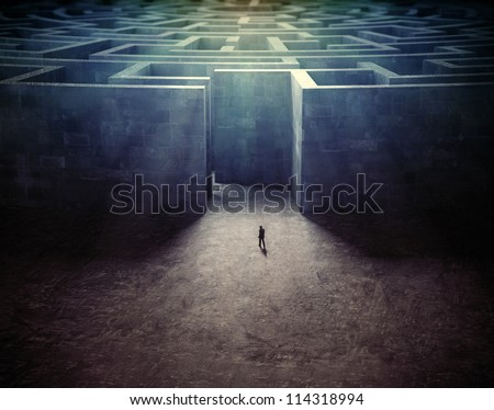 Tiny man entering a mysterious maze - stock photo